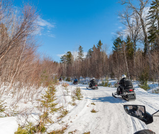 Snowmobilers taking off
