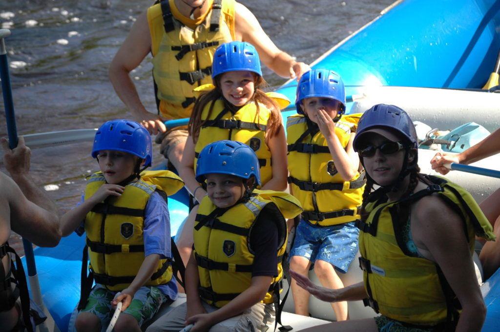 Kids rafting with NEOC