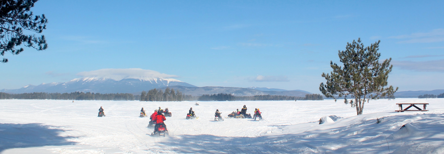 Snowmobiling in Maine with NEOC