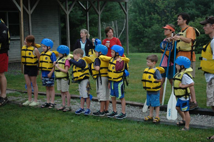 kids lining up for whitewater rafting