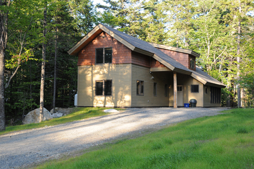 Summer view of a Coveside Cabin at NEOC