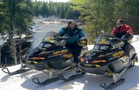 Group snowmobiling in Maine
