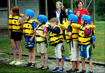 Children line up for whitewater rafting