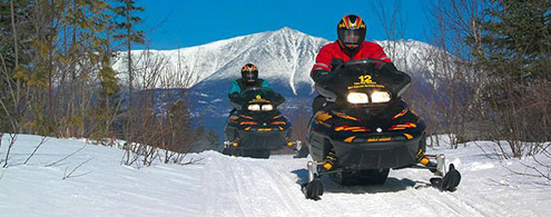 Skidoo sleds in front of Katahdin