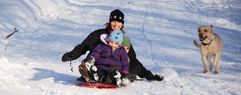 Sledding off black cat