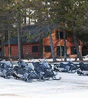 Photo of large fleet of snowmobiles at NEOC